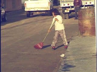 A young girl was doing her chores early in the morning.