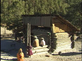 Melina's family in front of their one-bedroom cabin.