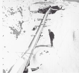 Father John at his snow covered placer mining site.